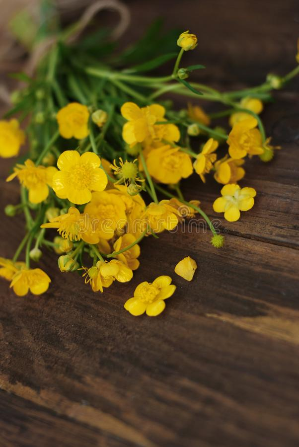 Yellow Little Flowers Bouquet gift Spring time Rustic Wooden Background Flat Lay. Yellow Little Flowers Bouquet gift Spring time Rustic Wooden Background stock photos
