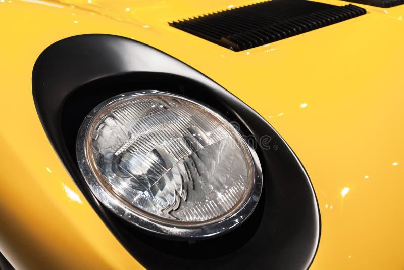 Yellow luxury vintage sport car headlight stock photos