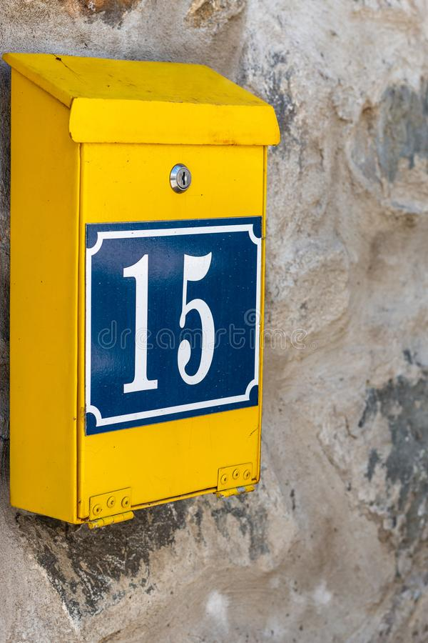 Yellow mailbox postbox royalty free stock image