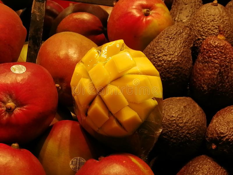 A yellow mango in a fruit basket. Yellow mango fruit market basket royalty free stock images