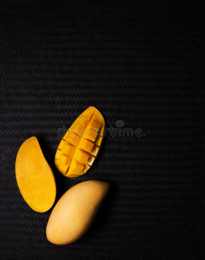 Yellow mango fruit on black stock photo