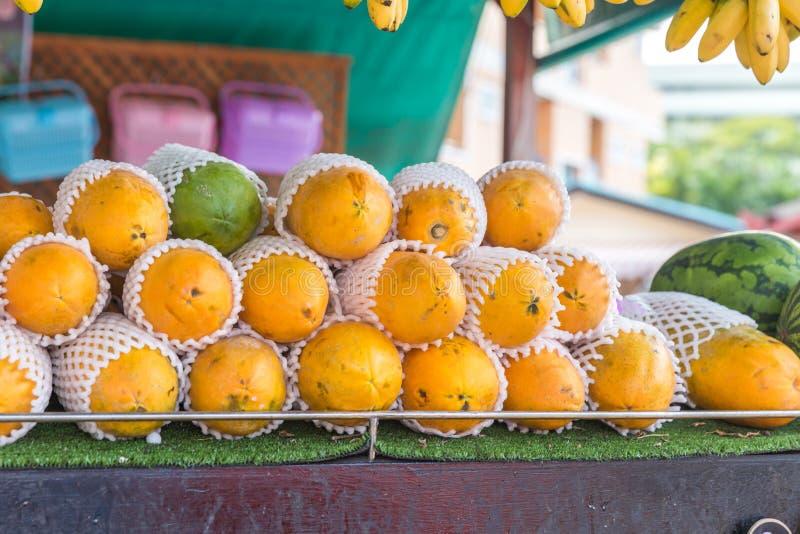 Yellow Mango on market - exotic thai fruits royalty free stock photos