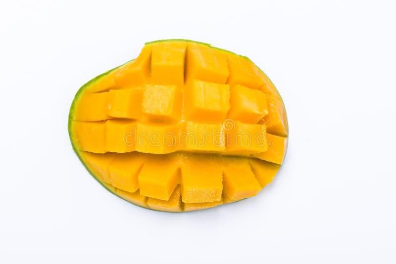 Yellow mango slice cut to cube isolated on white stock photos