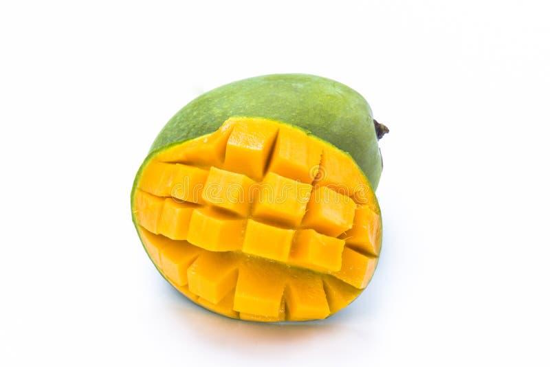 Yellow mango slice cut to cube isolated on white stock image