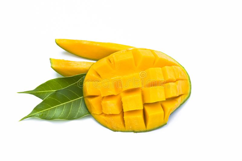 Yellow mango slice cut to cube with leaf isolated on white royalty free stock image