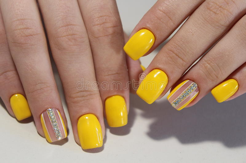 Yellow manicure nail design with stones. 2017 stock images