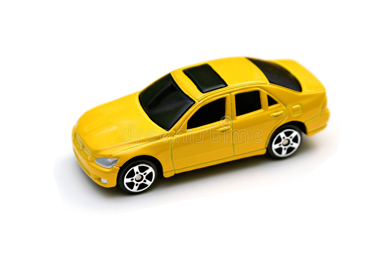Yellow Matchbox Car. Yellow matchbox sports car with silver wheels and tinted wheels stock images