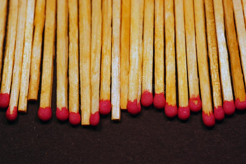 A row of matches with heads of red sulfur royalty free stock photo