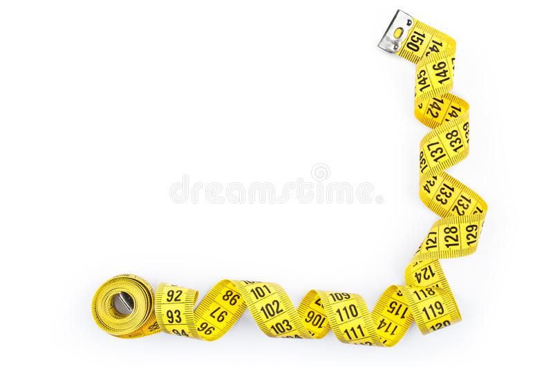Yellow measuring tape. Isolated on white stock images