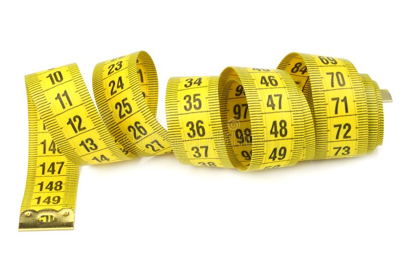 Yellow measuring tape isolated on white background stock photos