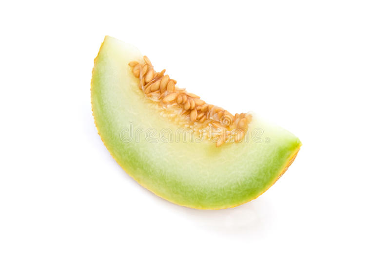 Yellow melon. Piece of a fresh yellow melon isolated on white background stock photos