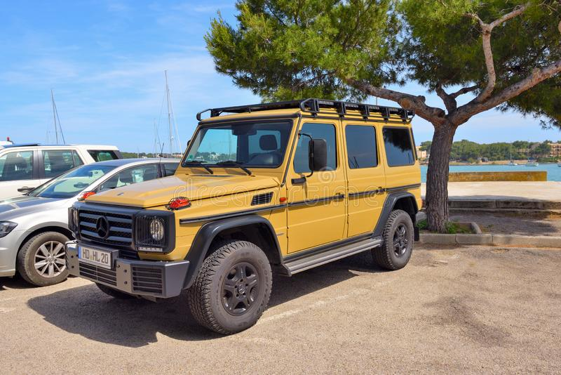 Yellow Mercedes Benz G-Class parked on the street stock images