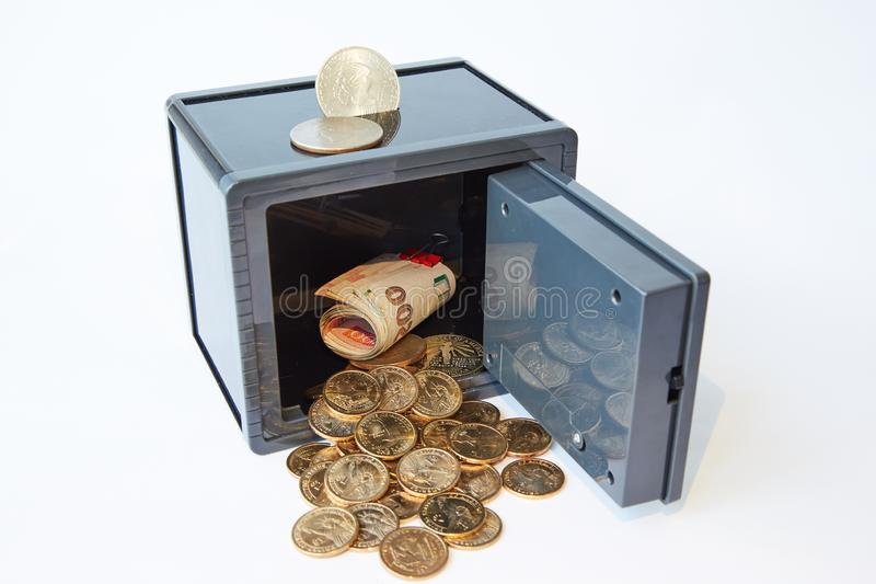Yellow metal dollars and bills different currencies in gray safe, isolated royalty free stock photos