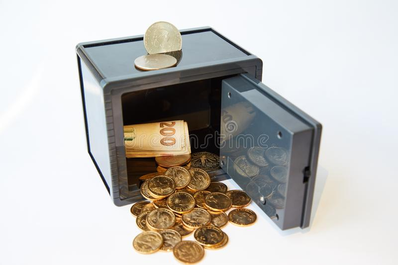 Yellow metal dollars and bills different currencies in gray safe, isolated royalty free stock photography