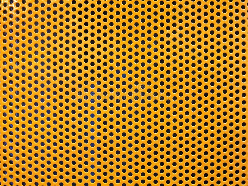 Yellow metal hole or perforated grid background stock images