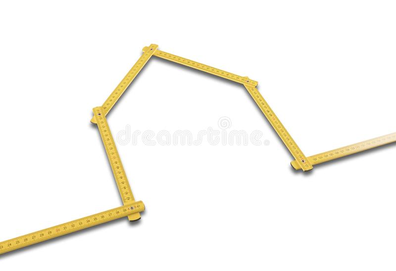 Yellow meter ruler folded as house. On white background royalty free stock photos