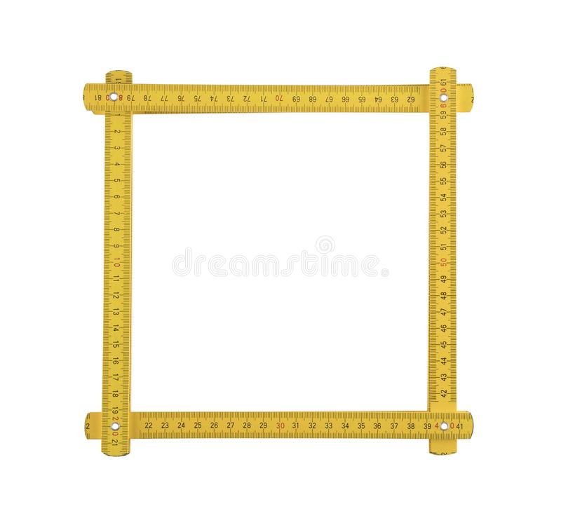 Yellow meter ruler frame on white background. Yellow meter ruler folded as frame isolated on white background royalty free stock photo