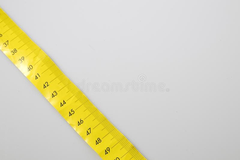 Yellow meter in a white backgraund. Composition stock image