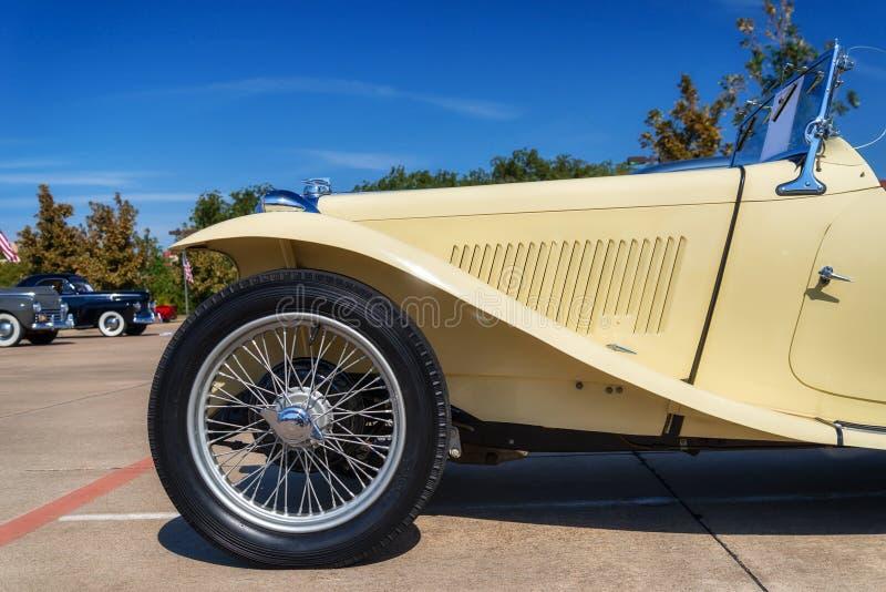 Yellow 1947 MG TC Roadster. A yellow 1947 MG TC Roadster classic car. Closeup of front side view stock photos