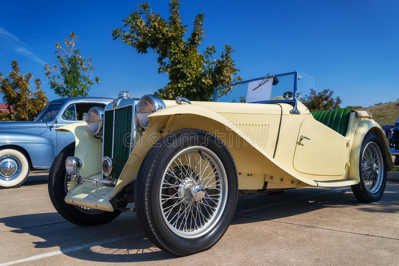 Yellow 1947 MG TC Roadster. A yellow 1947 MG TC Roadster classic car. Front side view royalty free stock images