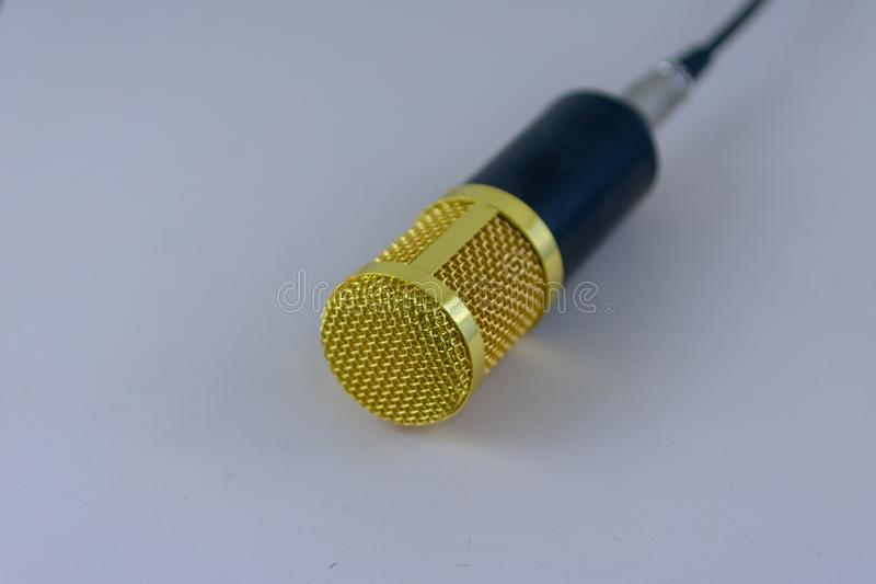 Yellow microphone on white royalty free stock photography