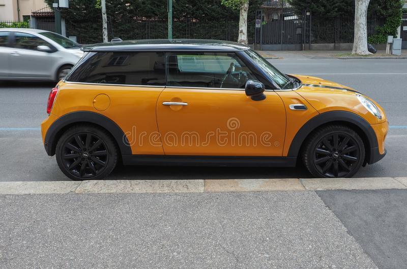 yellow Mini car in Turin royalty free stock photo