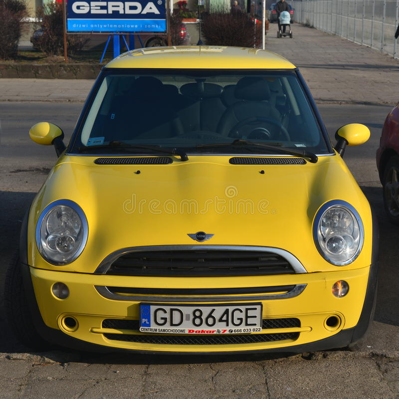 Yellow Mini Cooper. Parked in Gdansk, Poland royalty free stock images