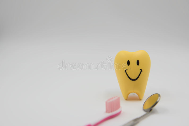 Yellow model smile Cute toys teeth in dentistry on a white background royalty free stock images