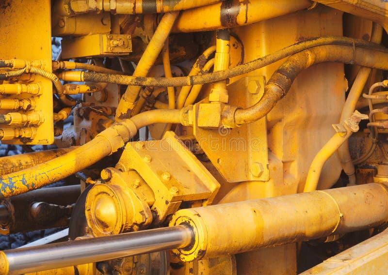 Yellow motor engine machine excavator hydraulic tractor vehicle closeup royalty free stock photo
