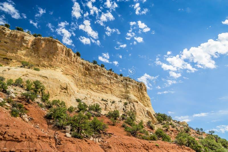 Yellow mountain atop red rock stock photo