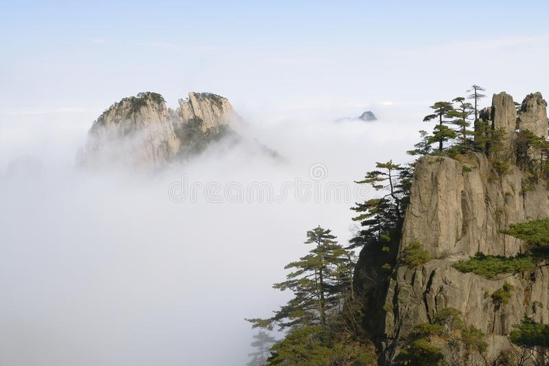 Yellow Mountain - Huangshan, China. View of mountains in the fog in Yellow Mountain - Huangshan, China royalty free stock image