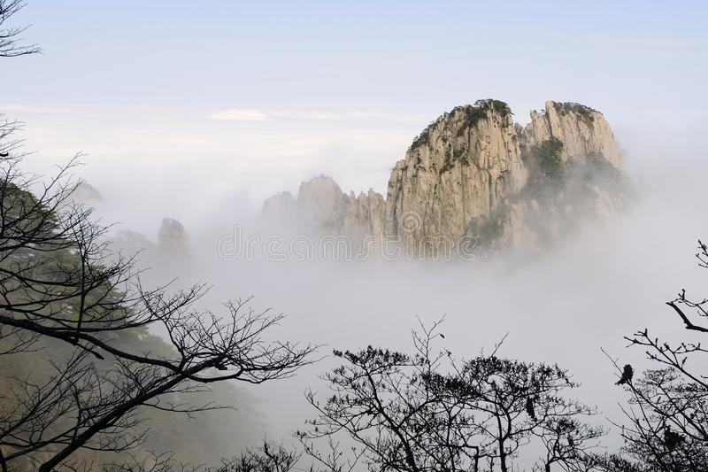 Yellow Mountain - Huangshan, China. View of mountains in the fog in Yellow Mountain - Huangshan, China royalty free stock photos