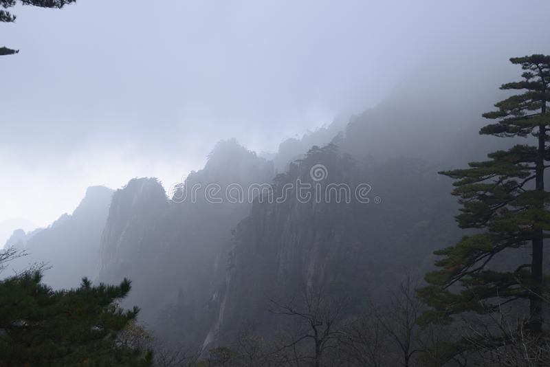 Yellow Mountain - Huangshan, China. View of mountains in the fog in Yellow Mountain - Huangshan, China stock images