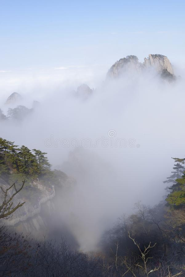 Yellow Mountain - Huangshan, China. View of mountains in the fog in Yellow Mountain - Huangshan, China royalty free stock images