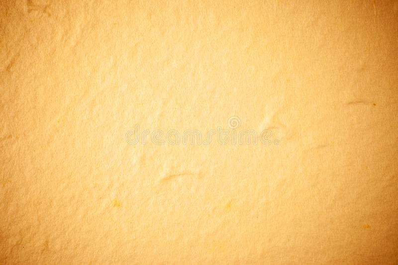 Yellow Mulberry paper background. Abstract, aged, antique, art, beautiful, beauty, blank, brown, cards, color, craft, crumpled, crunch, decorative, design royalty free stock photos