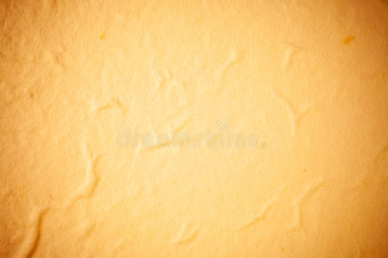 Yellow Mulberry paper background. Abstract, aged, antique, art, beautiful, beauty, blank, brown, cards, color, craft, crumpled, crunch, decorative, design royalty free stock images