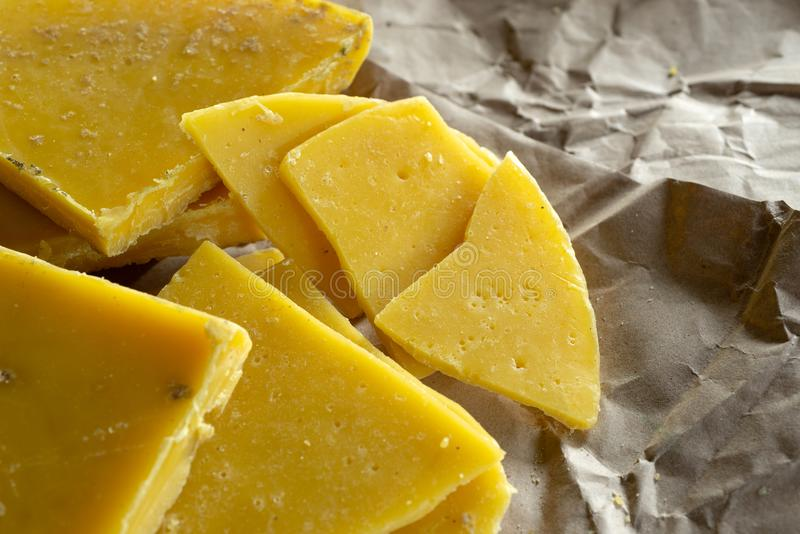 Yellow natural beeswax stock photo