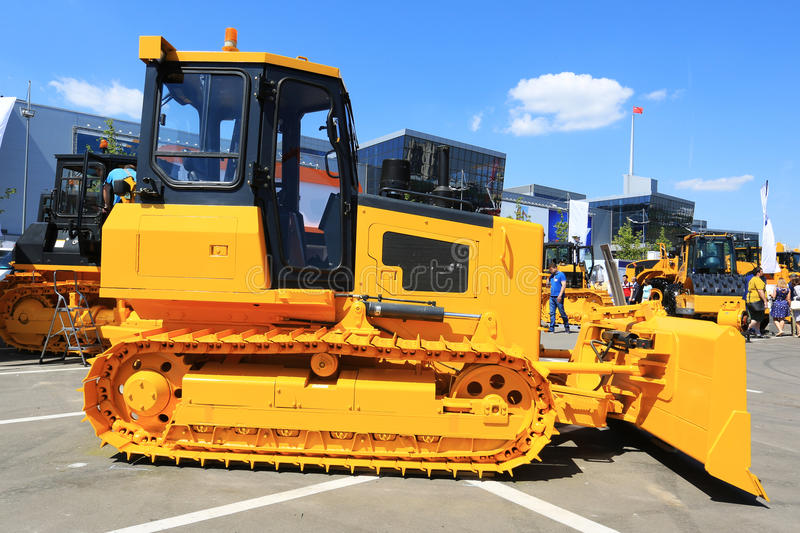 Yellow new tractor. Industry engineering and construction royalty free stock photos