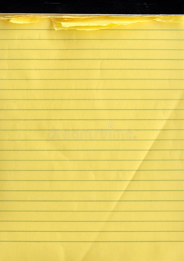 A yellow note pad royalty free stock image