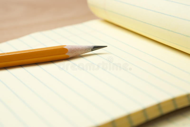 Yellow Notepad with Pencil stock photos