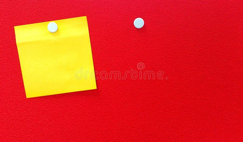 Download Yellow notepad on red wall stock image. Image of note - 42734611