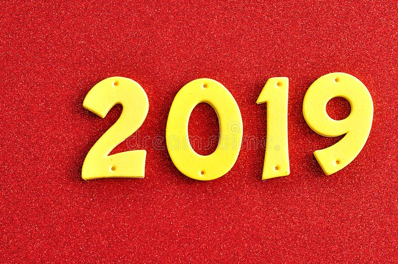 2019 in yellow numbers. On a red background stock photos