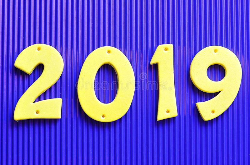 2019 in yellow numbers. On a blue background stock images