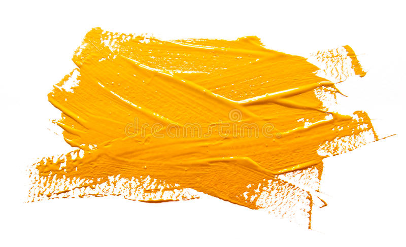 Yellow ochre strokes of the paint brush isolated. On a white royalty free stock image