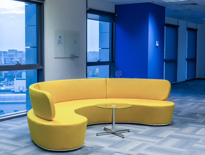 Yellow office sofa. Big modern design yellow sofa in office royalty free stock images