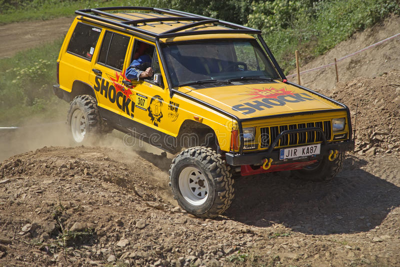 Yellow offroad car on the trial race. MOHELNICE, CZECH REPUBLIC - JUNE 07: Yellow offroad car in the Championship of the Czech Republic in the off road tech royalty free stock images