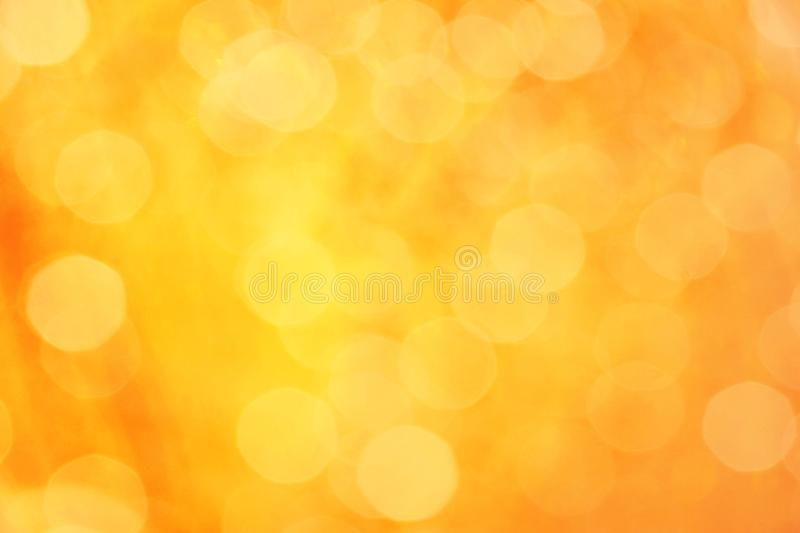 Orange bokeh abstract light background. Yellow and orange color abstract bacground withe blurred defocus bokeh light for template stock photos