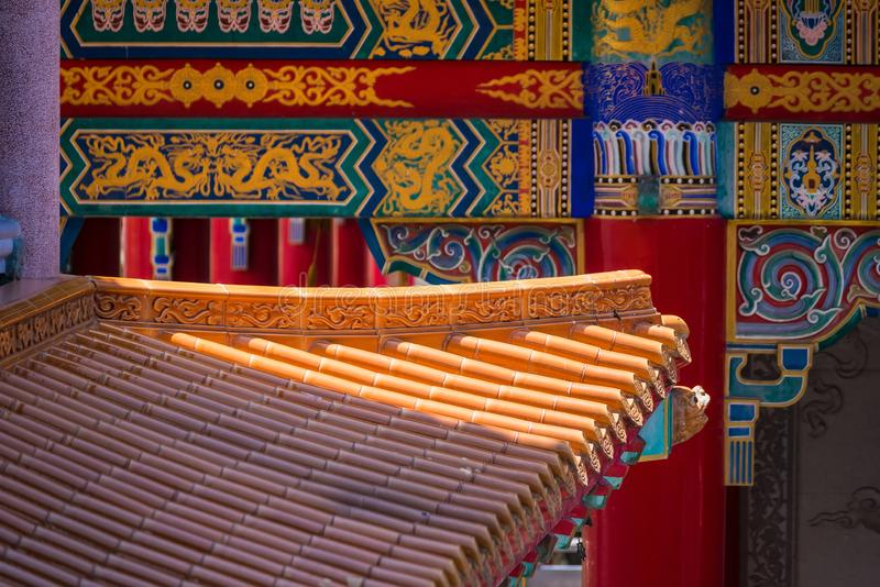 Yellow orange glazed terracotta  roof tiles of a Chinese temple stock image