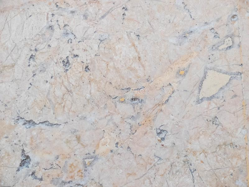 Yellow, orange and gray marble texture. Stone background seamless pattern.  royalty free stock photography