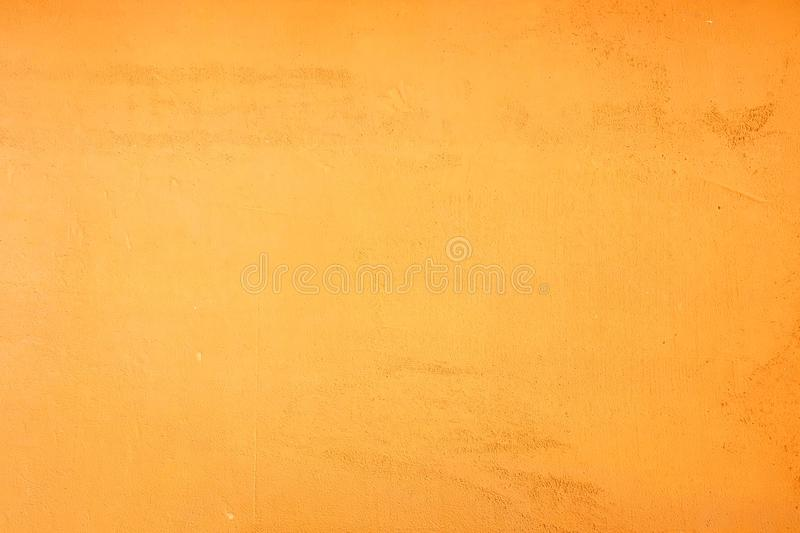 Yellow orange grunge wall color and texture background royalty free stock images